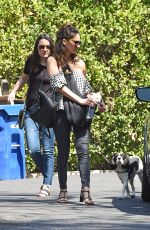 OLIVIA MUNN Carrying Her Dog in a Dog Pouch Out in Los Angeles 04/10/2018