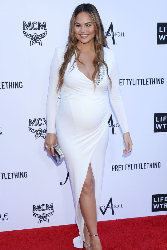 Pregnant CHRISSY TEIGEN at Daily Front Row Fashion Awards in Los Angeles 04/08/2018