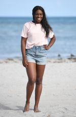 SLOANE STEPHENS Poses with Miami Open Championship Trophy at Crandon Beach 03/31/2018