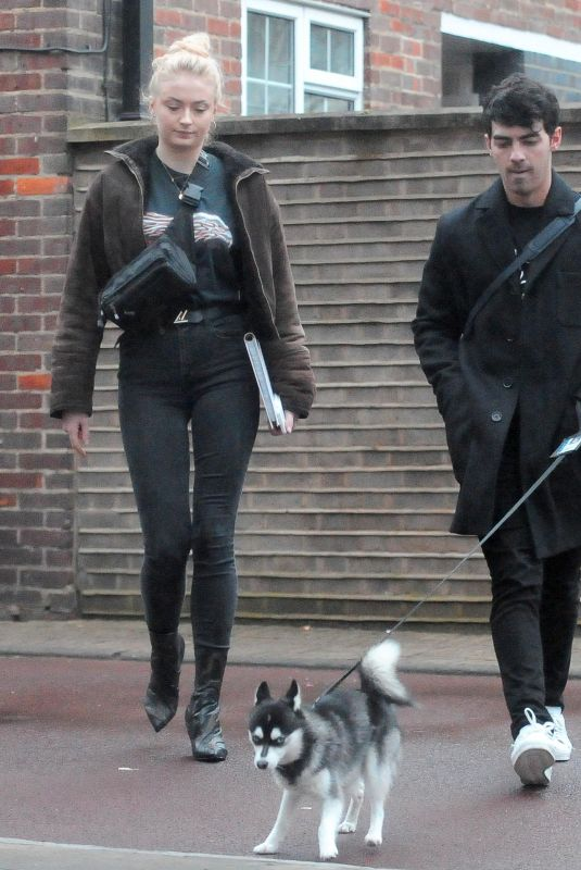 SOPHIE TURNER and Joe Jonas Walks Their Dog Out in London 04/03/2018
