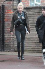 SOPHIE TURNER and Joe Jonas Walks Their Dog Out in London 04/03/2018