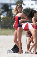 TONI GARRN and ALINA BAIKOVA in Swimsuit at a Beach in Miami 04/01/2018