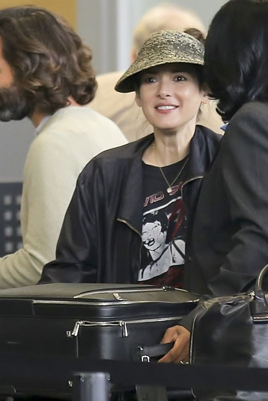 WINONA RYDER at LAX Airport in Los Angeles 04/15/2018