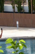 YAZMIN OUKHELLOU in Bikini at a Pool in Magaluf 04/22/2018