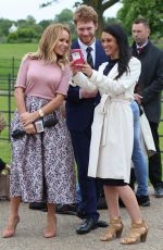 AMANDA HOLDEN Interviewing Harry and Meghan Lookalikes at Kensington Palace in London 05/16/2018