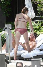 ASHLEY GREENE in Bikini at a Pool in Miami 05/10/2018