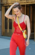BELLA THORNE All in Red Leaves Her Hotel in New York 05/24/2018