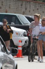 CHARLOTTE MCKINNEY and IRELAND BALDWIN Out in Malibu 05/05/2018