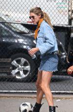 DOUTZEN KROES in Denim Skirt at a Park in New York 05/07/2018