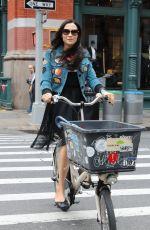 FAMKE JANSSEN Out Riding a Bike in New York 05/06/2018