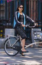FAMKE JANSSEN Riding Bike Out in New York 05/14/2018