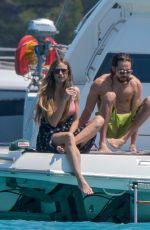 HEIDI KLUM in Bikini at a Yacht in Cannes 05/19/2018