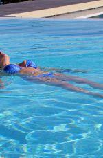 IMOGEN THOMAS in Bikini at a Pool in Magnisia 05/29/2018