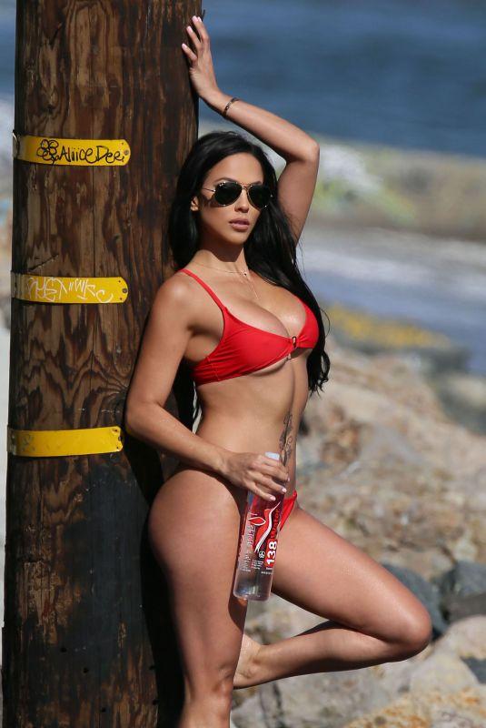 MELISSA RISO in Bikini for 138 Water at a Beach in Malibu 05/17/2018