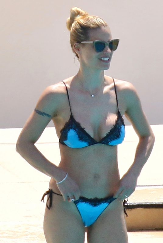 MICHELLE HUNZIKER in Bikini at a Swimming Pool in Monaco 05/19/2018