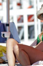 MICHELLE HUNZIKER in Bikini at Varigotti Beach 05/13/2018