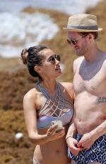 ANNA SHARYPOVA in Bikini and Andre Schurrle at a Beach in Tulum 05/28/2018