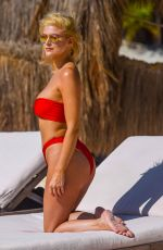 ASHLEY JAMES in Bikini on the Beach in Ibiza 06/07/2018