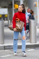BELLA HADID in Ripped Jeans at JFK Airport in New York 06/02/2018