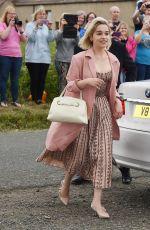 EMILIA CLARKE Arrives at Kit Harington and Rose Leslie