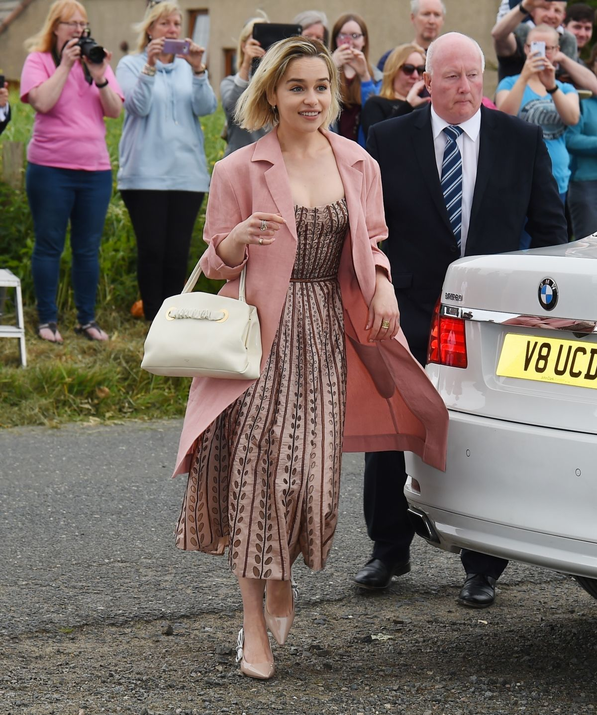 Emilia Clarke Arrives At Kit Harington And Rose Leslies Wedding In