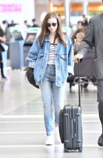 LILY COLLINS in Double Denim at LAX Airport in Los Angeles 06/04/2018