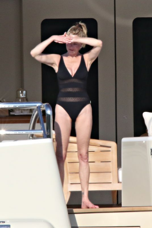 MELANIE GRIFFITH in Swimsuit at a Boat in Sardinia 06/20/2018