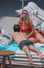 RHIAN SUDGEN in Bikini at a Pool in Ibiza 06/14/2018