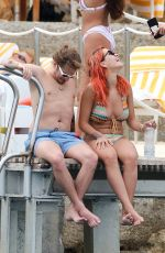 RITA ORA in Bikini at a Beach in Tuscany 06/06/2018