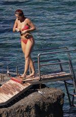 RITA ORA in Red Bikini at a Beach in Tuscany 06/05/2018
