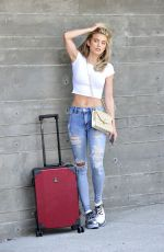 ANNALYNNE MCCORD in Ripped Jeans at LAX Airport in Los Angeles 07/03/2018