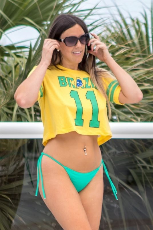 CLAUDIA ROMANI in a Brazil Jersey and Bikini Bottom at a Pool in Miami 07/01/2018
