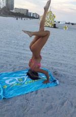 CLAUDIA ROMANI in Bikini Doing Yoga in South Beach 07/16/2018