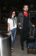 COURTENEY COX and Johnny McDaid at LAX Airport in Los Angeles 07/27/2018