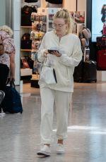 DAKOTA FANNING at Heathrow Airport in London 07/16/2018