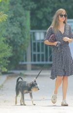 DAKOTA JOHNSON Out with Her Dog in New York 07/21/2018