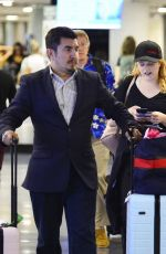 ELIZABETH MOSS at LAX Airport in Los Angeles 07/10/2018