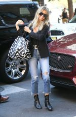 HEIDI KLUM in Ripped Jeans Arrives at Her Hotel in New York 07/19/2018