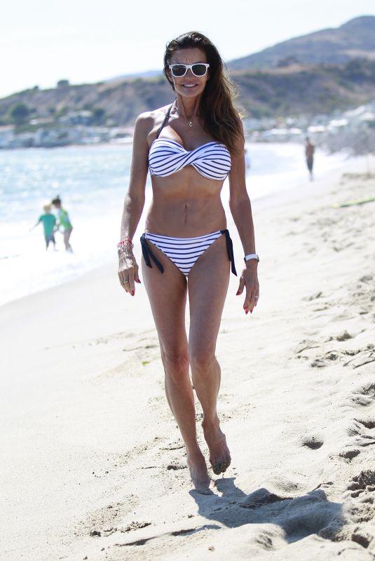 JANICE DICKINSON in Bikini at a Beach in Malibu 07/04/2018