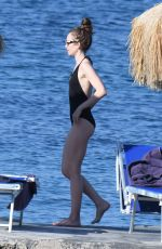 LILY COLLINS in Swimsuit at a Beach in Ischia 07/18/2018