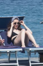 LILY COLLINS inSwimsuit at Hotel Regina Isabella in Ischia Porto 07/15/2018