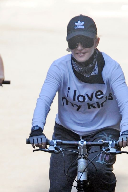 MADONNA Out on Her Bike in London 07/11/2018