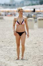 MICHELLE HUNZIKER in Bikini on the Beach in Italy 07/04/2018