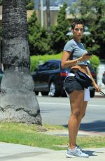 NICOLE MURPHY in Shorts Out with Her Dog in Beverly Hills 07/21/2018
