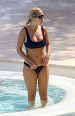 RITA ORA in Bikini at a Pool in French Riviera 07/02/2018