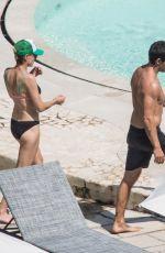 ROBIN WRIGHT in Bikini at a Pool in Positano 07/25/2018