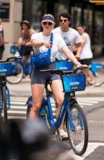 SOPHIE TURNER at a Ride on Citibikes to Celebrate 4th of July in New York 07/04/2018
