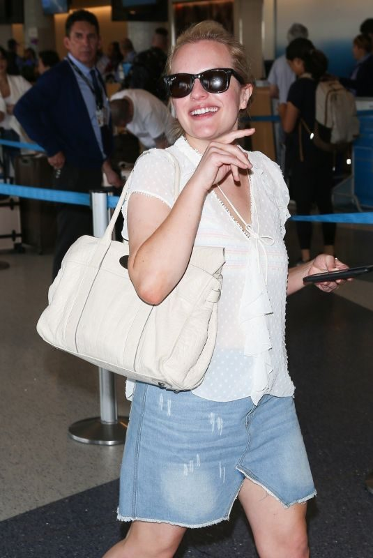 ELISABETH MOSS at LAX Airport in Los Angeles 08/27/2018