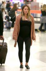 Pregnant HILARY DUFF at JFK Airport in New York 08/26/2018