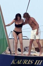 TAHNEE ATKINSON in Bikini at a Boat in Sardinia 08/10/2018